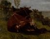Paysage : vache rousse couchée